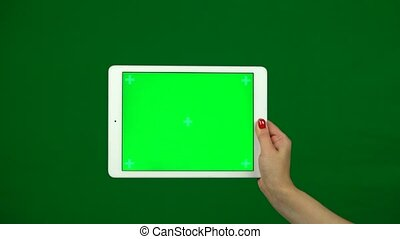 Laptop computer in the hands with green screen