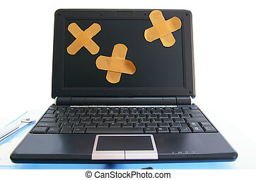 laptop computer with bandages - computer repair, or online...