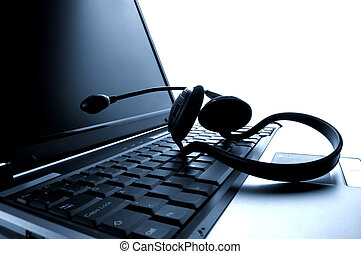 laptop computer with headset close up shoot