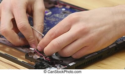 Laptop disassembling in repair shop, close-up. Disassembled...
