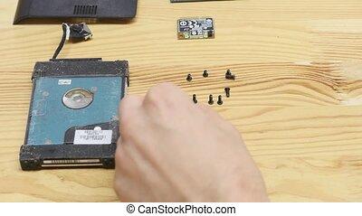 Laptop disassembling in repair shop, close-up. Disassembled...