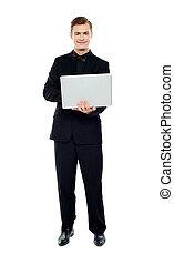 laptop, homem, jovem, trabalhando, sorrindo