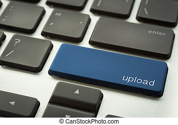 Laptop keyboard with typographic UPLOAD button - Close up ...