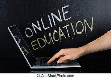 laptop, mano, persona, linea, usando, educazione