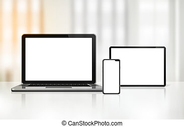 Laptop, mobile phone and digital tablet pc on office desk