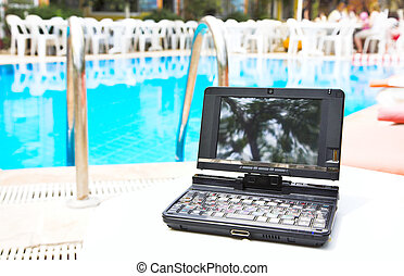 laptop near pool