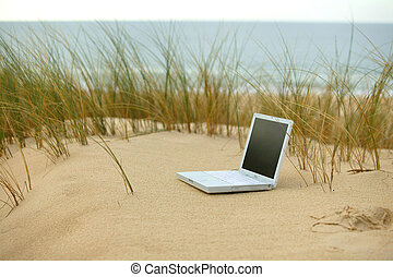 Laptop on a beach