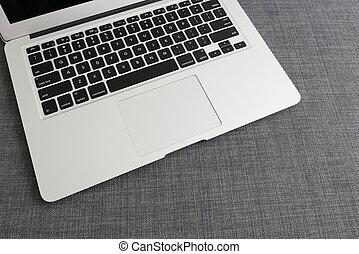 Laptop on blue cloth background