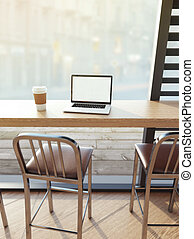 Laptop on cafe table - Laptop on the table in bright cafe. ...