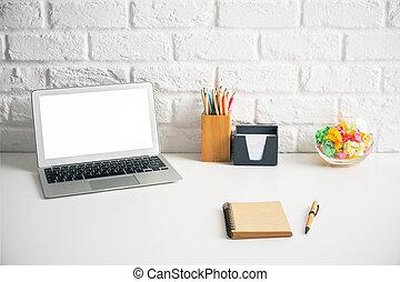 Laptop on creative desktop