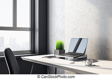 Laptop on designer workplace with blank screen