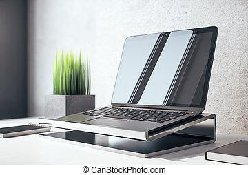 Laptop on modern designer workplace