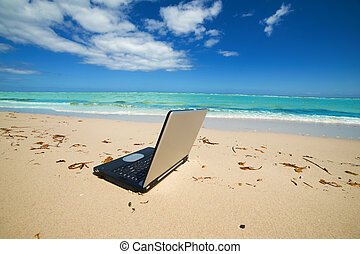 laptop on the beach as a ??freelance idea