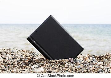 Laptop on the beach