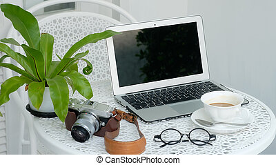 laptop on the table with coffee