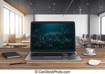 Laptop on wooden desk with chart on screen