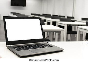 Laptop, online business, teacher work in the classroom. Laptop put on a table or desk