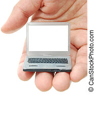 Laptop - Hand holding a miniature laptop with a blank screen