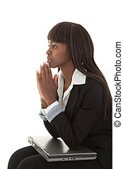Young black women pondering with elbows on laptop