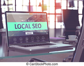Laptop Screen with Local SEO Concept. - Modern Workplace...