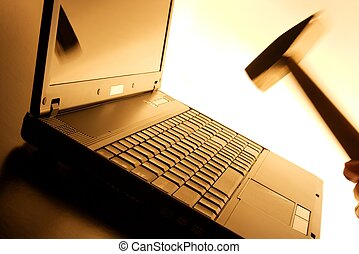 Laptop smash - Laptop about to being hit by a hammer