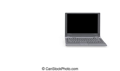 Laptop spinning on white background