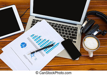Laptop, tablet , smartphone and coffee cup with financial...