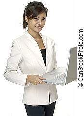 Laptop User - A pretty young asian woman uses a laptop ...