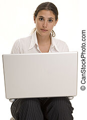 Laptop User - An attractive young woman sits with a laptop ...