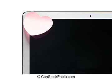 Laptop with a sticky note in the shape of a heart
