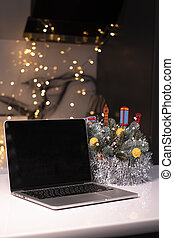 laptop with black screen near New Year's decorations. christmas theme. template