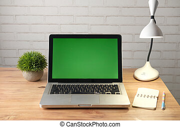 laptop with blank screen on office desk.