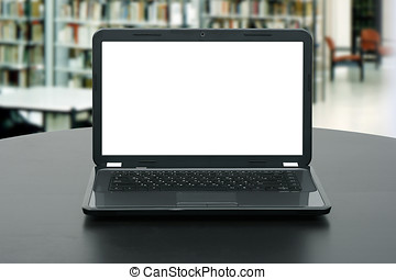 laptop with blank screen on the table in library