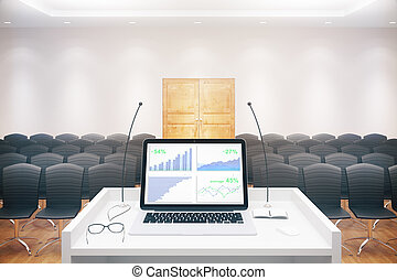 Laptop with chart conference hall