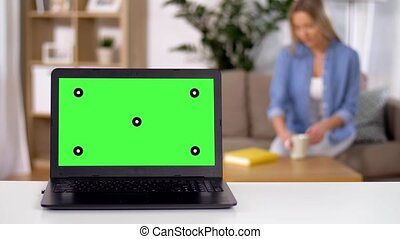 laptop with chroma key green screen on table - technology...