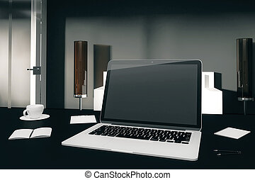 Laptop with diary, cup of coffee and othe accesories on the table in modern office