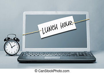 lunch hour - laptop with note about lunch hour