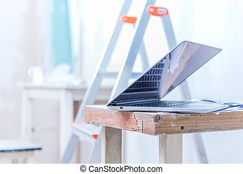 Laptop with Remodeling Plans