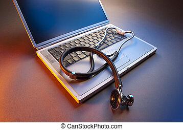 Laptop with stethoscope orange