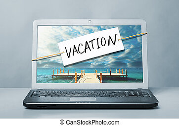laptop with vacation note - laptop with note about vacation
