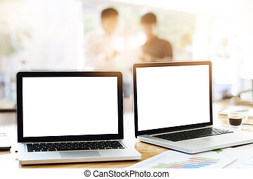 Laptops in office with business teamwork discuss