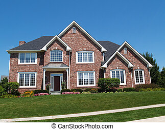 Exterior of a large two story brick residential home containing plenty of copy space,