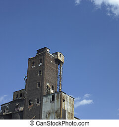 Large abandonned factory made of bricks and metal
