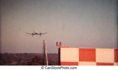 Large Airplane Landing-1958 - A large airplane comes in for...