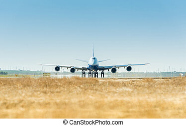 Large airplane on the runway ready for takeoff