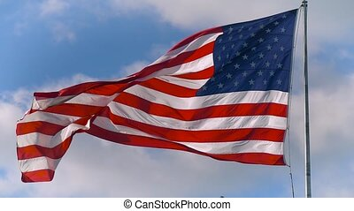 Large American flag gently waving in the wind