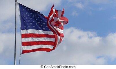Large American flag waving, slow motion video HD