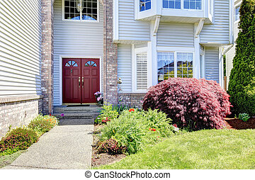 Large American house with red door.