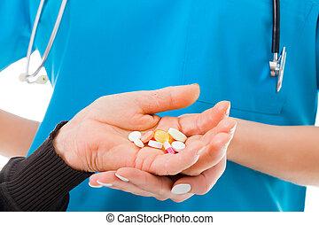 Large amount of prescription drugs - Elderly hands holding...