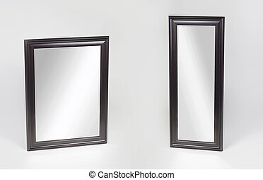 Large and small black framed mirrors isolated on white background